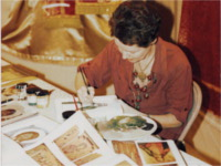 An iconographer works at a St. Nicholas bazaar